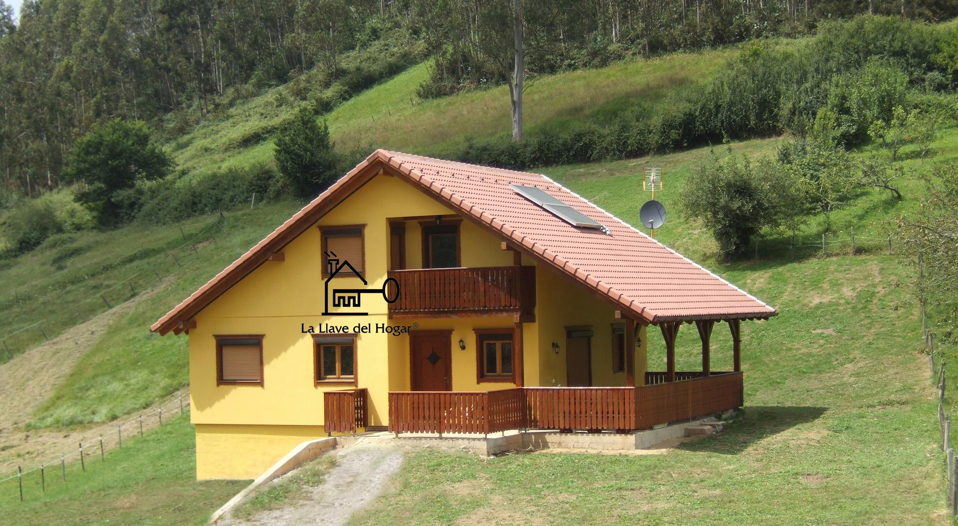 Casa de madera de entramado ligero con fachada de obra