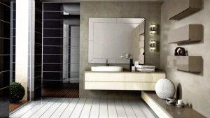 baño de diseño con mueble suspendido y suelo de madera blanca