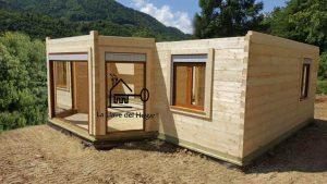 casa de madera de troncos con uniones de cola de milano